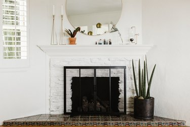 White brick fireplace with plant