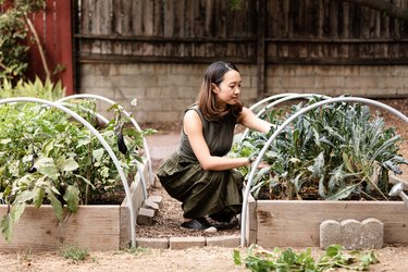 woman outside with vegetables