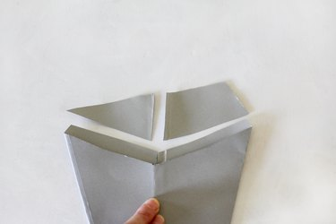Excess paper cut off cone shape