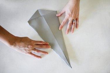 Flattening paper into cone shape
