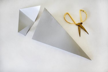 Cutting off part of paper to make Christmas star