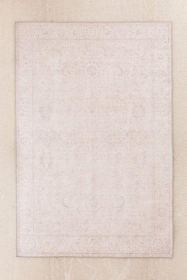 Beige area rug with subtle border
