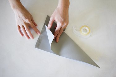 Taping paper together to make Christmas star
