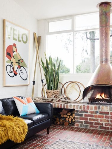 midcentury fireplace with brick hearth