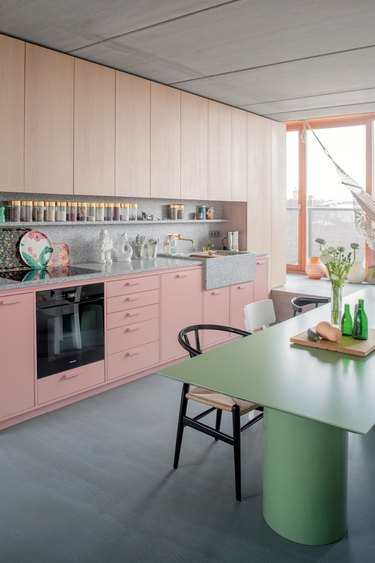 two-tone kitchen cabinets with pink and light wood finish