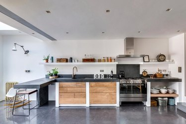open kitchen with concrete flooring and wood accents