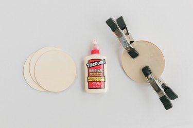 Glue three of the circles together to create a thicker circle.