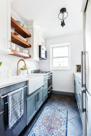two-tone kitchen cabinets with white and green cabinets in galley kitchen