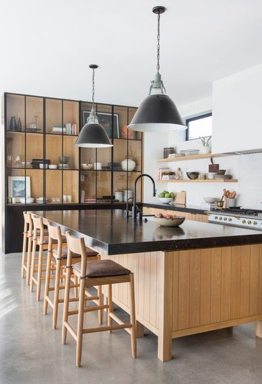 concrete kitchen floors in modern kitchen with black accents and light wood