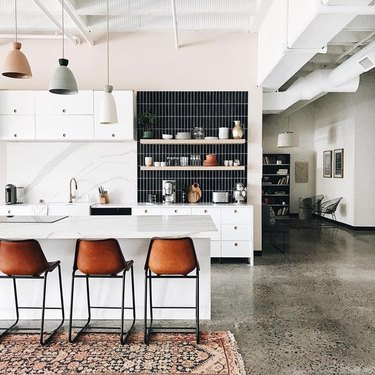 polished concrete kitchen floors in modern kitchen with area rug