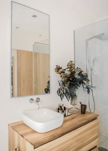 wood countertop and vanity cabinet with vessel sink