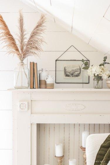 neutral farmhouse mantel decorating idea with white shiplap walls