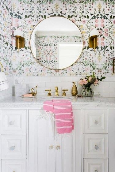 bathroom backsplash idea with white subway tile and floral patterned wallpaper