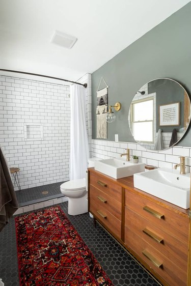 Double bathroom vanity with white vessel sinks and subway tile backsplash