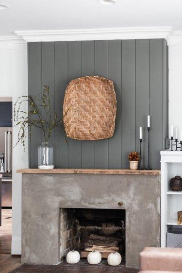 rustic minimalist farmhouse mantel decorating idea with concrete fireplace surround