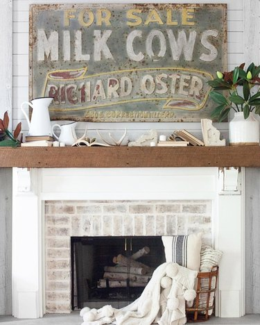rustic farmhouse mantel decorating idea with ceramic wood pitcher and reclaimed wood