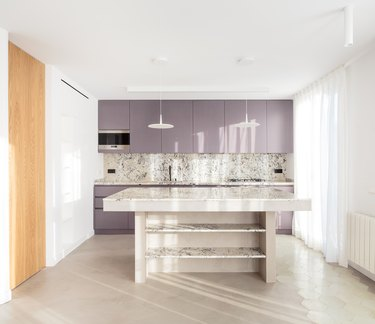 modern kitchen island with thick countertop and open shelving