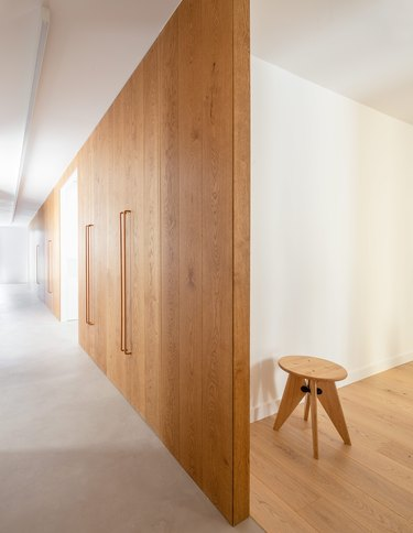 hallway with wood doors