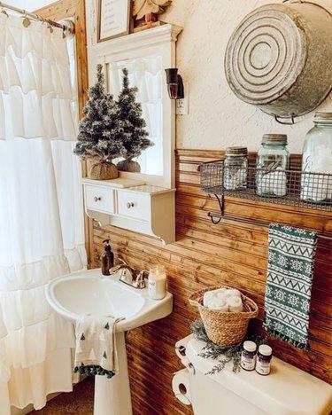 bathroom with wood backsplash and white sink