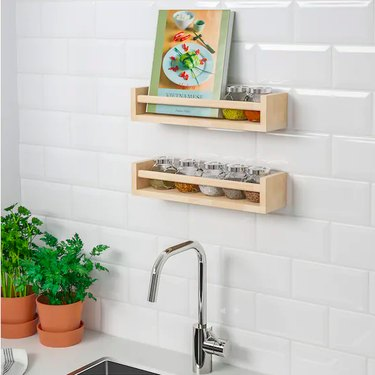 kitchen sink with shelves above it