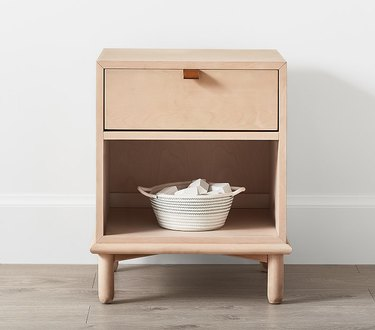 Blonde nightstand with large opening