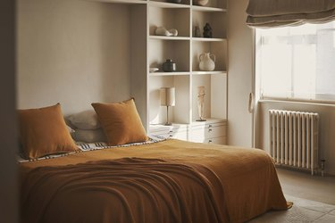 on-trend bedroom with ochre bed linens
