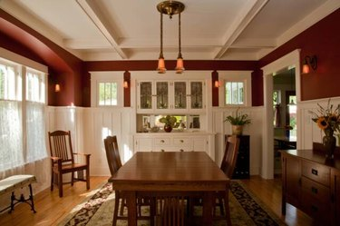 craftsman style dining room with white built-in cabinets and wood table and chairs