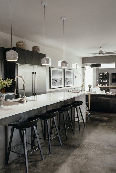 gray kitchen with concrete floor and bar seating