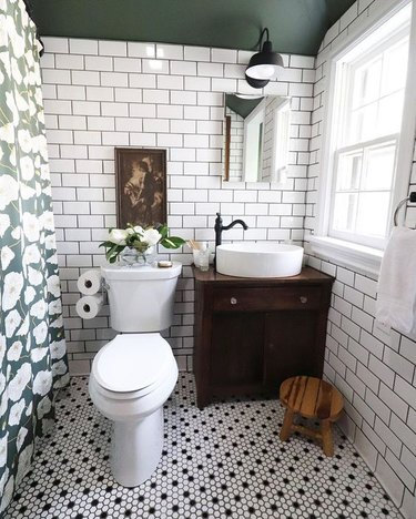 small farmhouse bathroom idea with subway tile walls and green paint