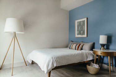 bedroom with blue accent wall