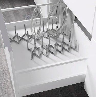 lid organizer inside white drawer