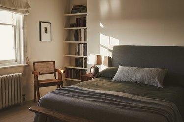 moody bedroom with slate bedding