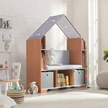 A reading nook with a bench and shelving
