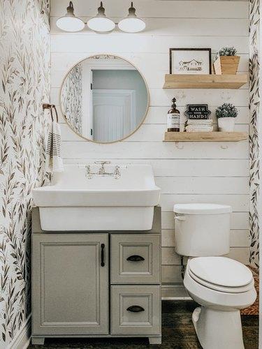 small farmhouse bathroom idea with shiplap backsplash and botanical wallpaper