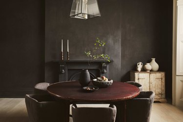 dramatic dining room with dark grey walls