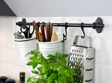 black rail with hanging kitchen accessories