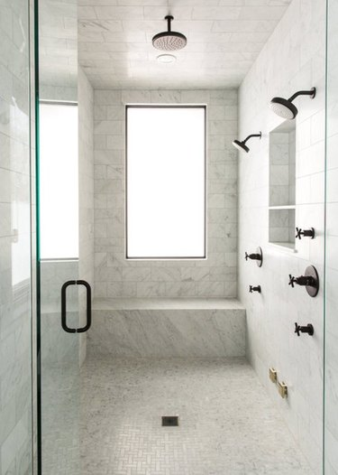 Turn your master shower into a serious spa with a rain shower head and built-in bench.