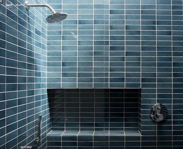 Blue steel-colored tile in modern shower.