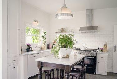 traditional boho farmhouse kitchen island idea with hand turned island