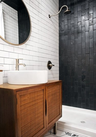 Black subway tiles with black grout in shower.