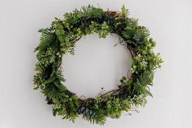 Faux evergreen wreath.
