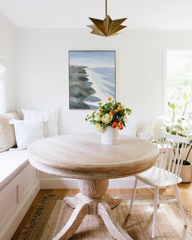 simple neutral dining room table centerpiece with round table