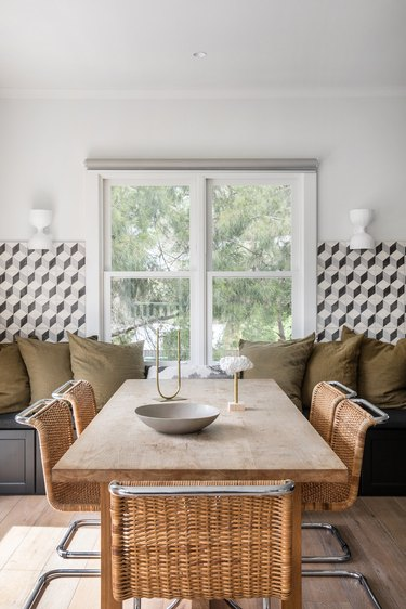 dining room table centerpiece in army green nook with black and white tile midcentury dining room