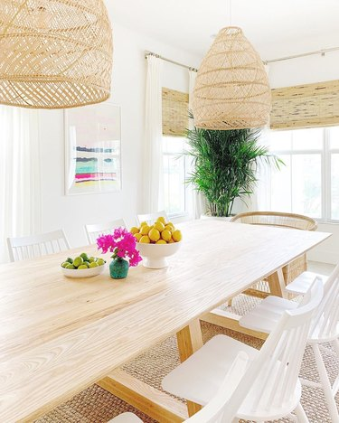 california style dining room table centerpiece with rattan pendants