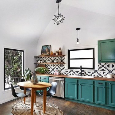 teal kitchen idea with black and white patterned backsplash