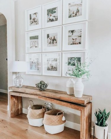farmhouse entryway with wooden bench and gallery wall