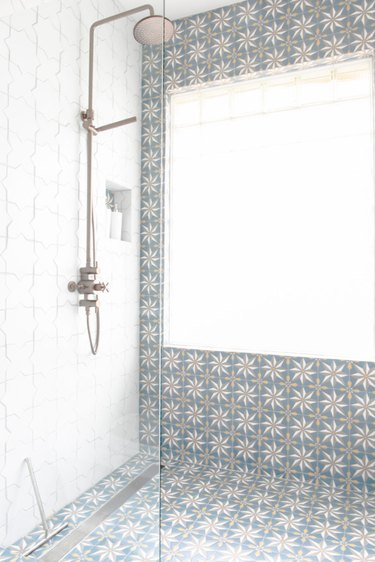 Star patterned tile in master shower.