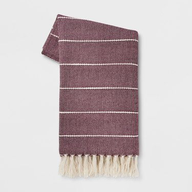 woven throw blanket with stripes and  tassel fringe