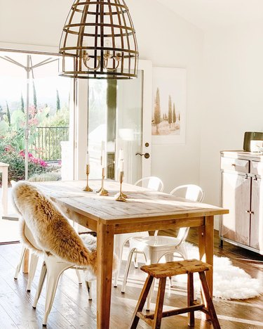 dining room table centerpiece with rustic table and metal chairs