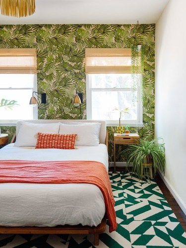 orange bedroom decor with tropical wallpaper